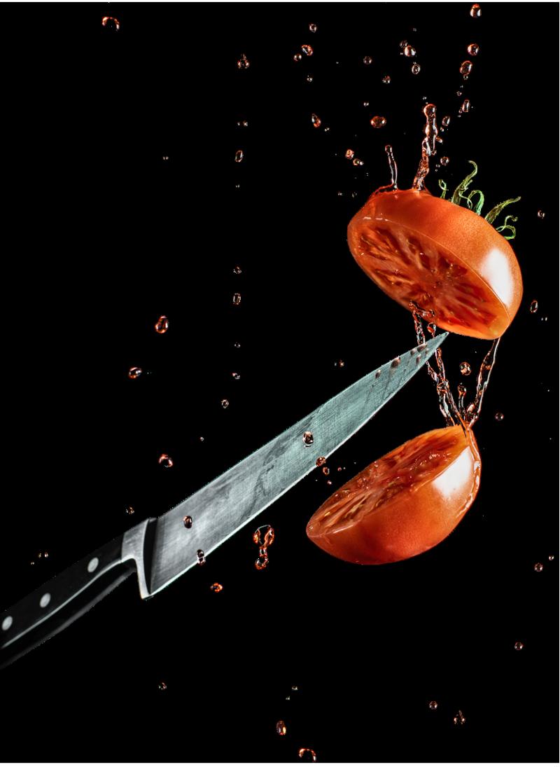 Knife cutting tomato